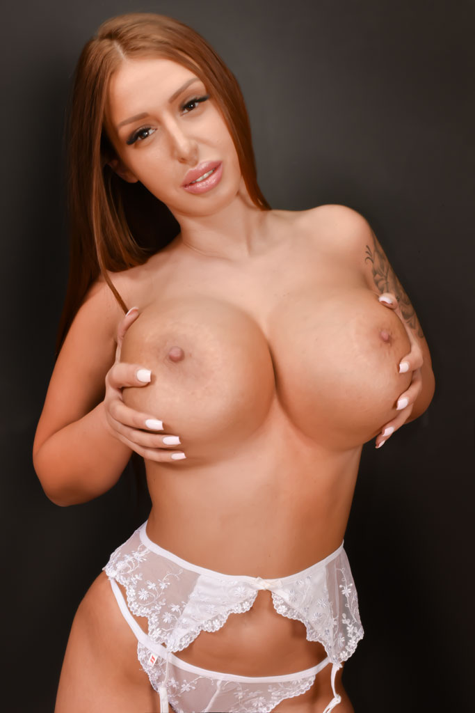A voluptuous woman with a natural E bust